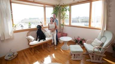 Suzanne and Glenn Rankin and their Labrador retriever,