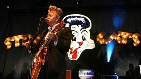 Brian Setzer of the Stray Cats performs in