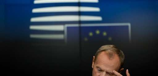 European Council President Donald Tusk touches his eyebrow