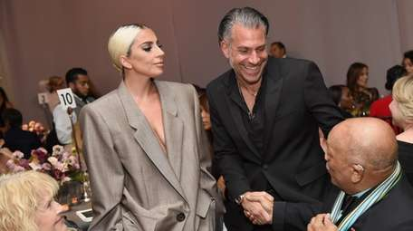 Lady Gaga and her fiance, Christian Carino, at