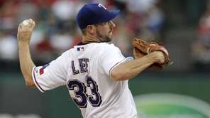 Texas Rangers starting pitcher Cliff Lee delivers to