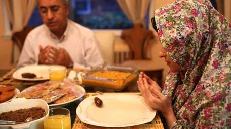 Morrow Habeeb and Seemi Ahmed pray just before