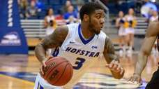 Hofstra guard Justin Wright-Foreman drives on Northeastern's Shawn