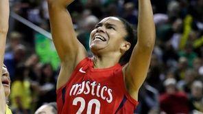 Washington Mystics' Kristi Toliver shoots over Seattle Storm's