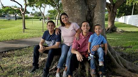 Melissa Rojas, here with her family, son Chris