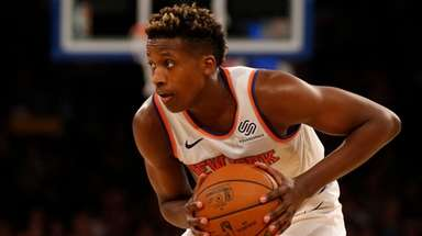 Frank Ntilikina #11 of the Knicks controls the