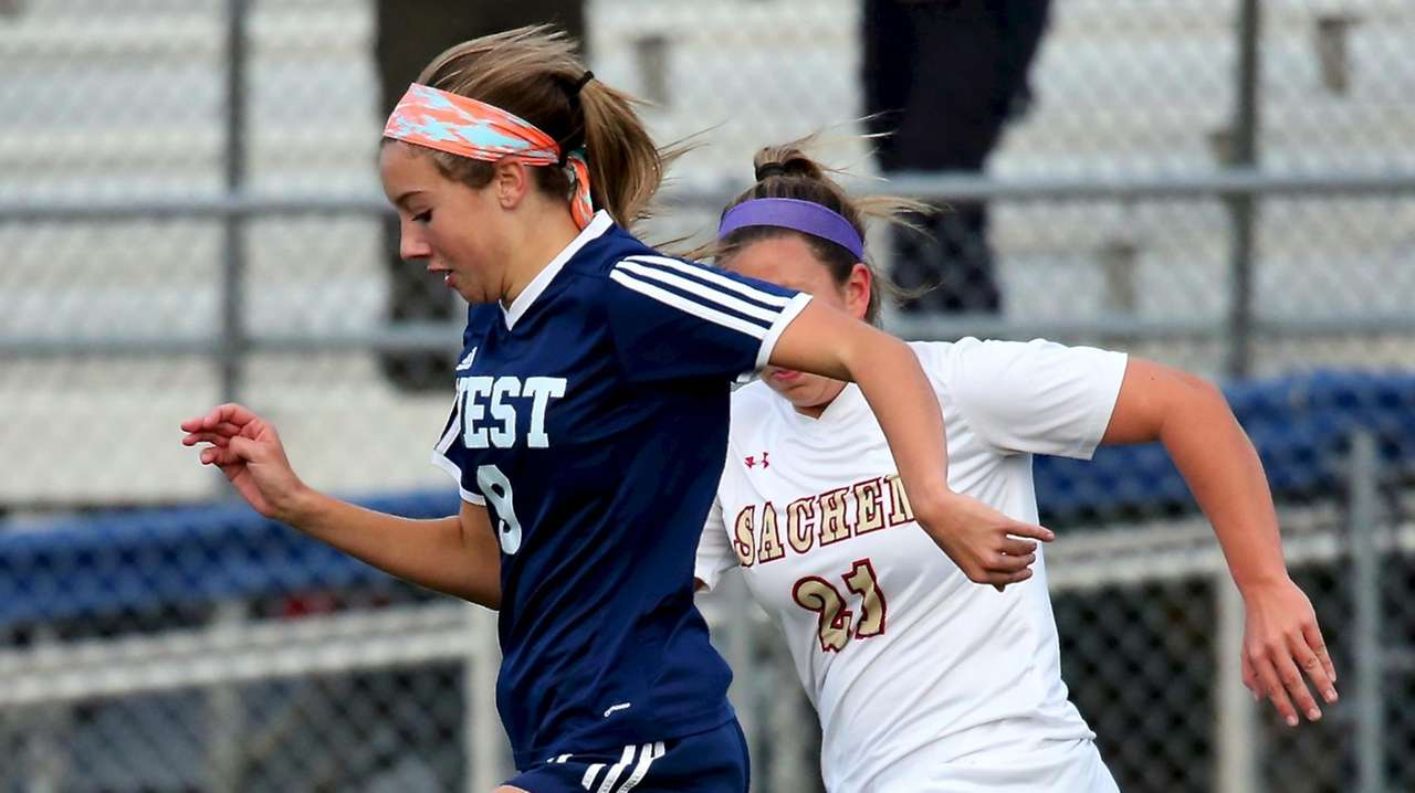 Smithtown West's Isabella Justino moves the ball into