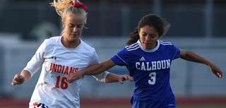 Tierney Harmon #16 of Manhasset, left, and Cailey