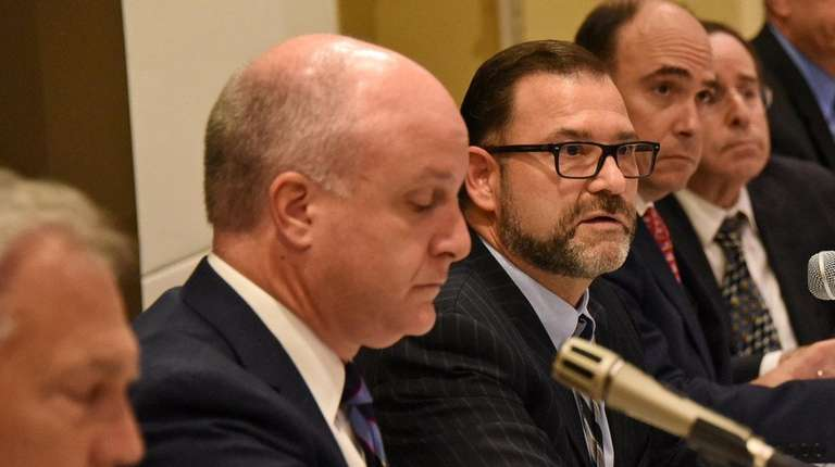 NIFA chairman Adam Barsky, center, during a meeting