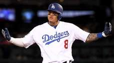 Manny Machado of the Dodgers reacts after hitting