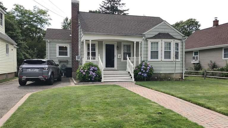 This Amityville ranch has three bedrooms and one