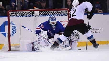 Rangers' Henrik Lundqvist saves a shot by Avalanche's