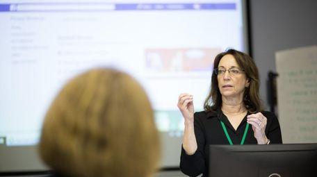 Jeri Usbay leads a SeniorNet Facebook Basics class