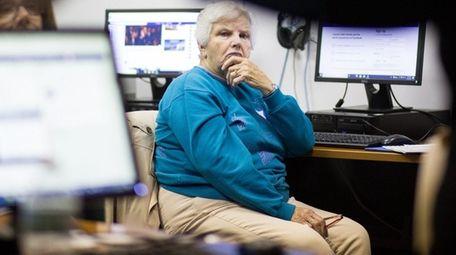 Helen Kaler, 80, of South Huntington looks on