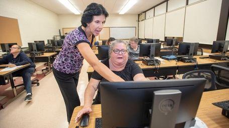 Cheryl Clifford, seen here teaching a SeniorNet class,