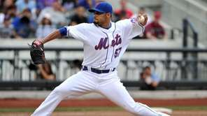 Mets starting pitcher Johan Santana throws in the