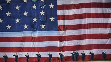 The Color Guard stands for the National Anthem