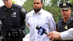 Mets' closer Francisco Rodriguez arrives in handcuffs at