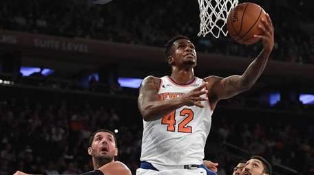 New York Knicks forward Lance Thomas puts up