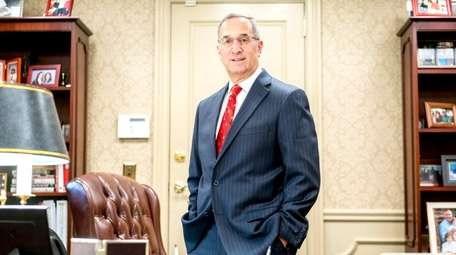 First National Bank of Long Island CEO Michael