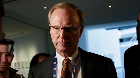 Giants owner John Mara speaks to reporters during