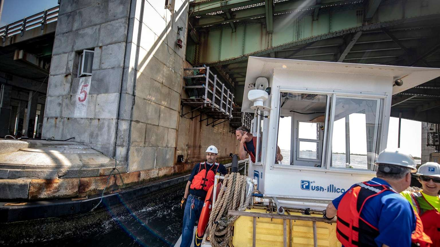 Posillico workers aboarda boat look over their drawbridgeproject in Wantagh Aug. 22, 2018.