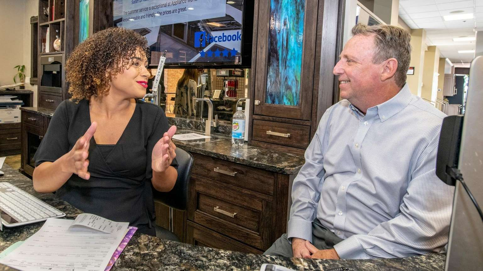 f444a84f9fc Administrative assistant DeAnna Meringola talks with owner Kevin  Nathan nbsp at Appliance World in Huntington on