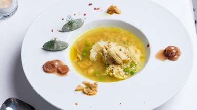 Curried chicken and rice soup with garbanzo beans,