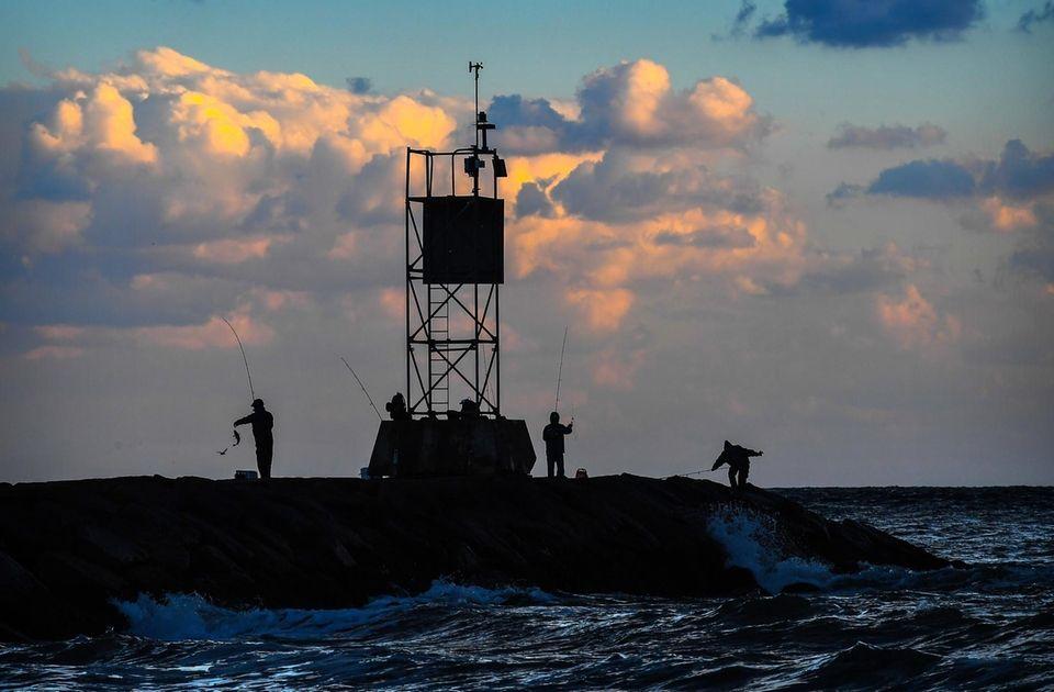 Fisherman on the jetty in Hampton Bays on