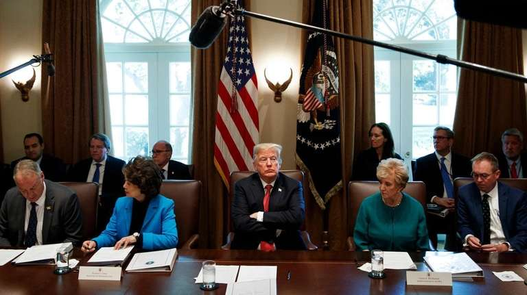 President Donald Trump listens during a cabinet meeting