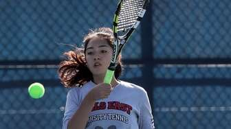 Half Hollow Hills East's Alexis Huber hits a