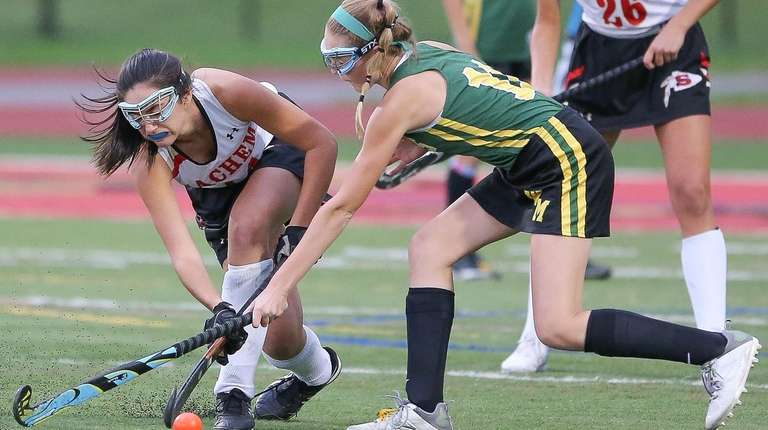 Sachem East's Lauren Lucas (14) and Ward Melville's