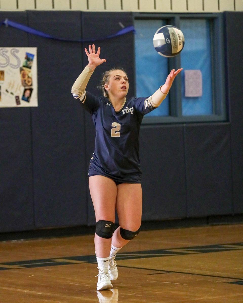 Hailey Prisinzano #2 of Bayport-Blue Point serves against