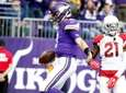 Vikings quarterback Kirk Cousins scores on a 7-yard