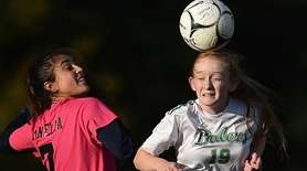 Emma Best #19 of Farmingdale, right, heads a