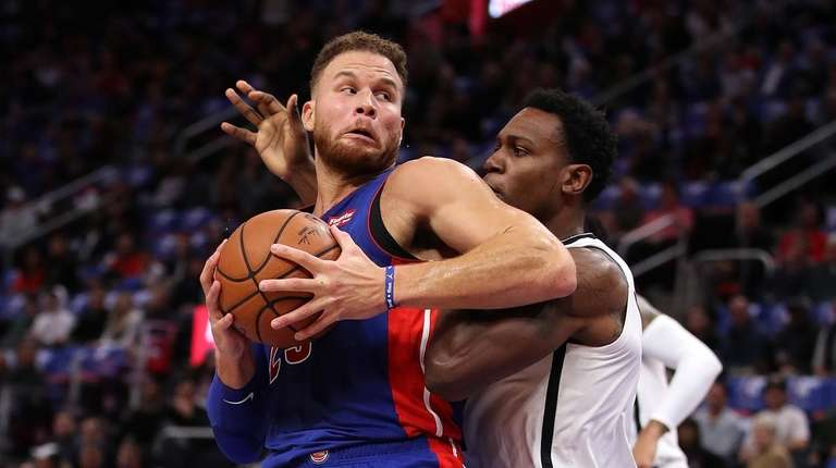 Blake Griffin #23 of the Detroit Pistons tries