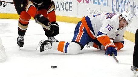 Anaheim Ducks defenseman Luke Schenn, left, knocks down