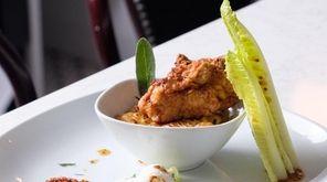 Chicken fried pork over rueben stuffing, romaine lettuce,