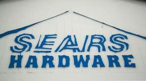 A sign for a Sears department store.