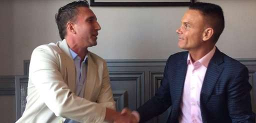StatementGames founder Marc Saulino, left, shakes hands with
