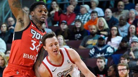 Erie BayHawks' Josh Magette drives past Raptors 905's