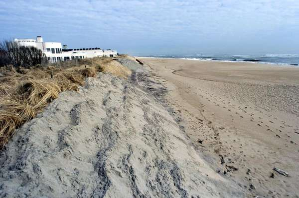 Coastal erosion imperils homes on the beach in