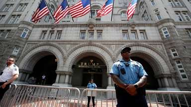 Law enforcement officers stand guard in front of