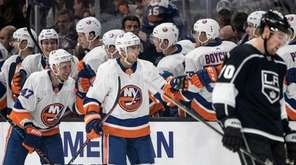 Islanders center Valtteri Filppula, center, celebrates his goal