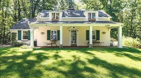 This Lloyd Harbor three-bedroom French chateau, with a