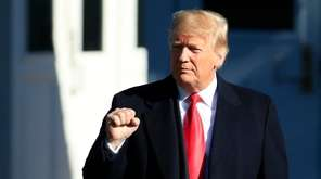 President Donald Trump gestures as he leaves the