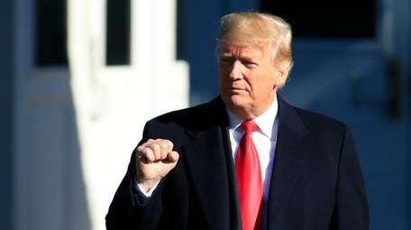 President Donald Trump leaves the White House on