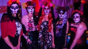 Attendees dressed in Sugar Skull regalia at last