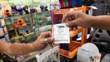 Customers purchase Mega Millions lottery tickets at Alina's