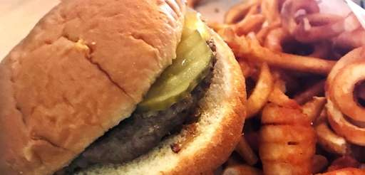 The steamed burger with curly fries is a